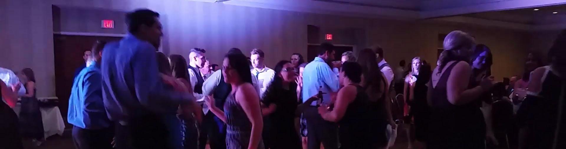 Dancing and singing to dj playing music